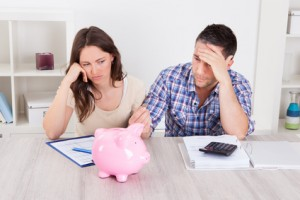 Couple Expecting Money From Piggybank